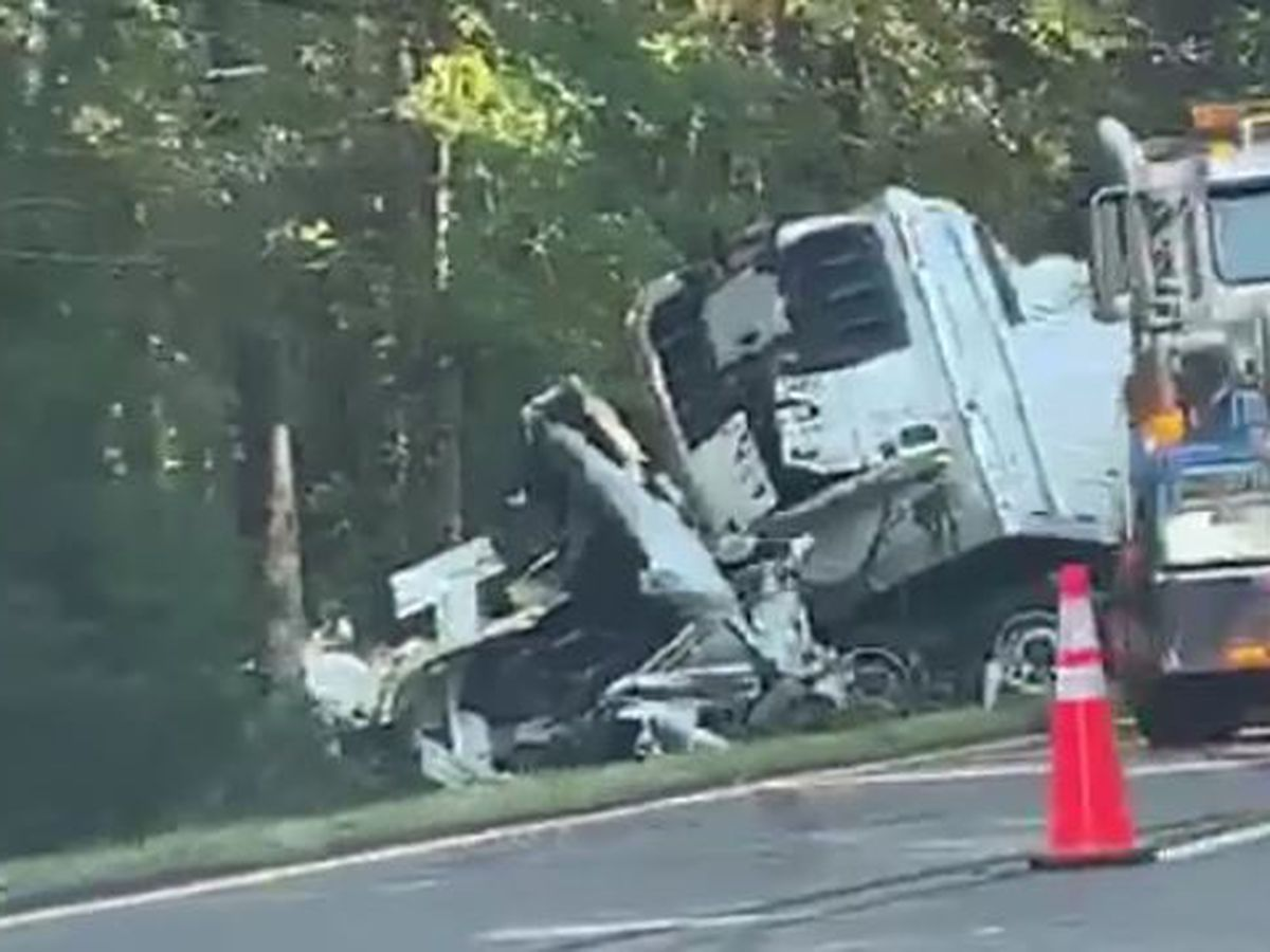 5 injured when tractor-trailer overturns on I-85