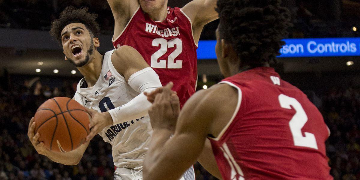 Marquette beats No. 12 Wisconsin 74-69 in OT; Howard has 27