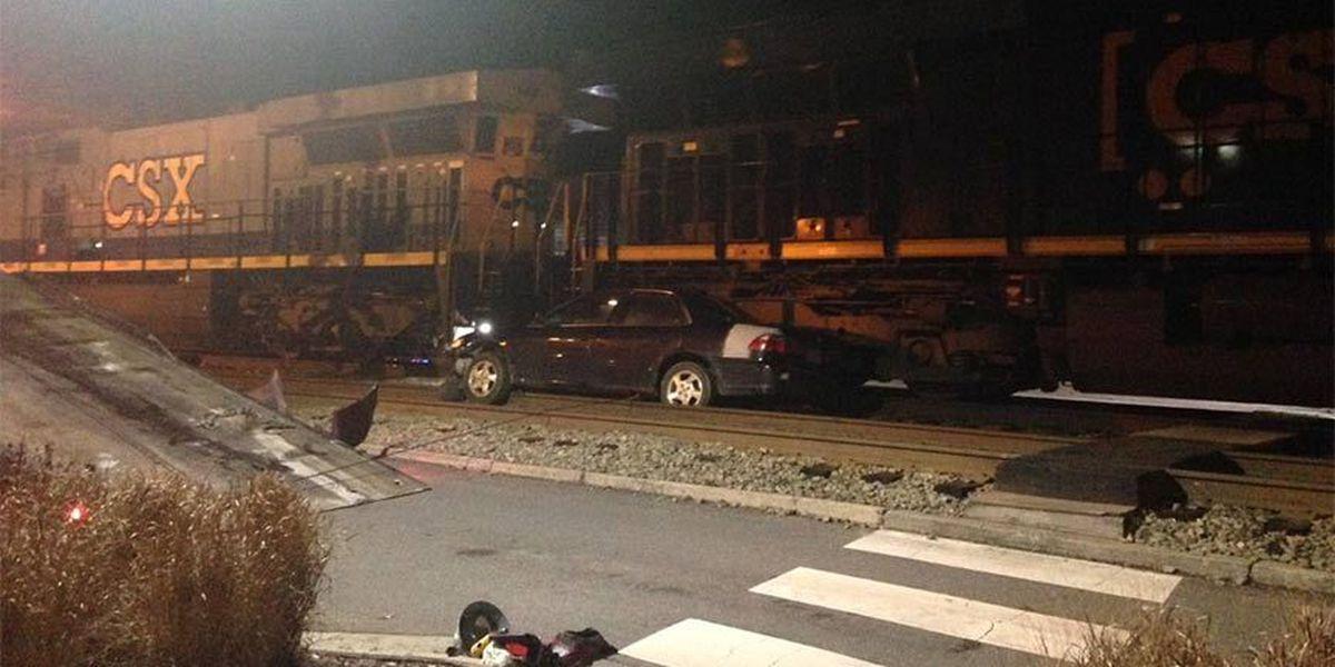 Train strikes car in Ashland