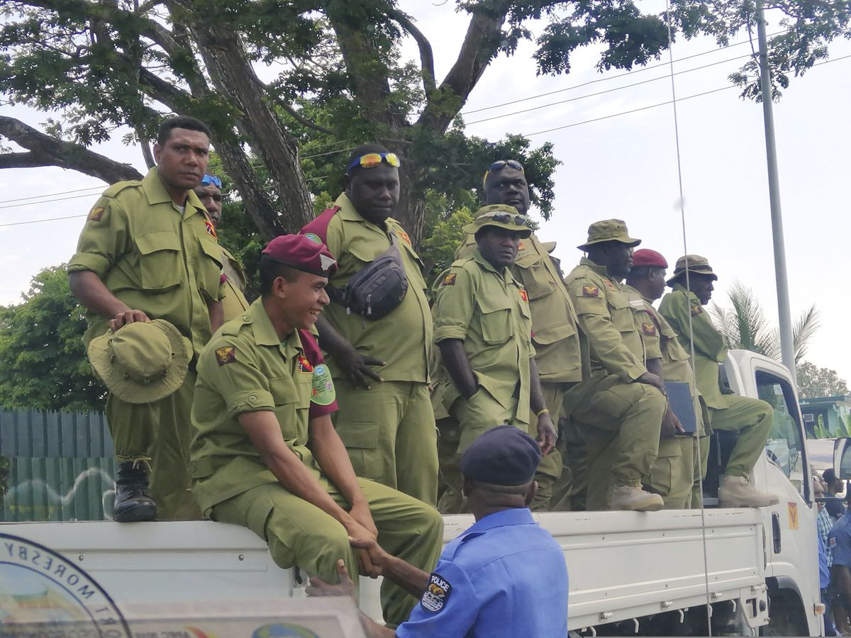 Police storm Papua New Guinea Parliament for APEC summit pay