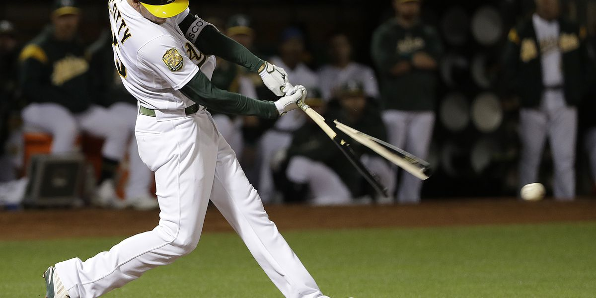 A's back Fiers with balanced offense, beat Yankees 8-2