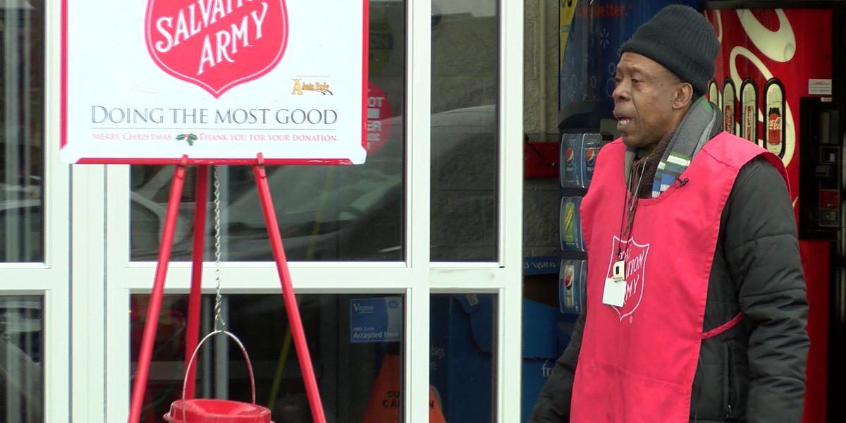 Bell ringer goes the extra mile by singing Christmas carols