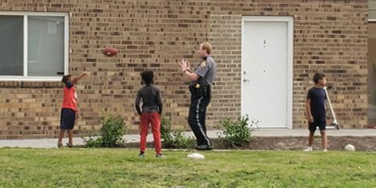 Henrico officer plays football with children