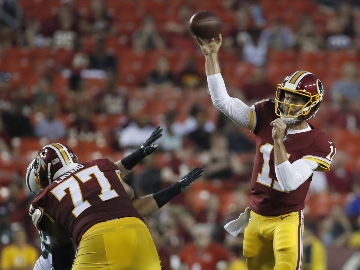 Redskins QB Alex Smith carted off field