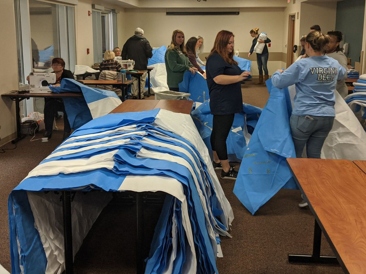 Hospital workers, volunteers stitch sleeping bags for the homeless