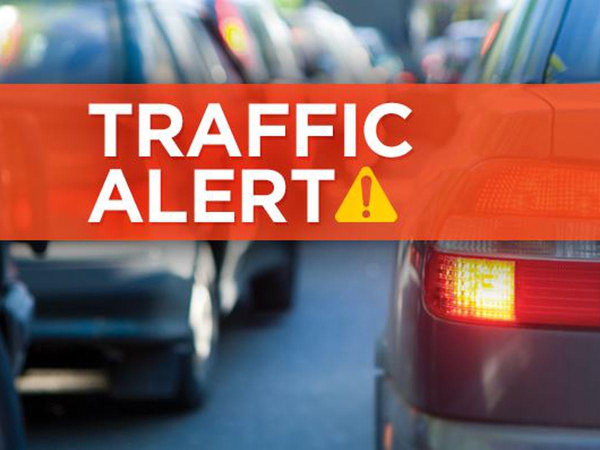 Crash damages power pole, causes road closure