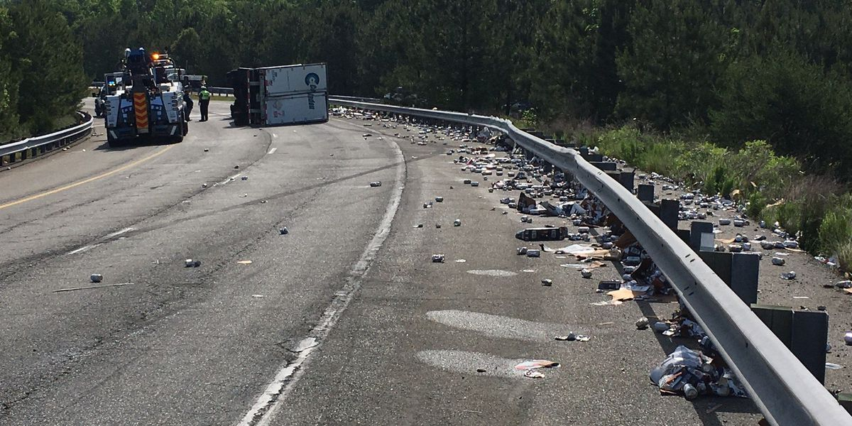 Tractor-trailer hauling beer overturns on I-295 S to I-64 E ramp in Henrico
