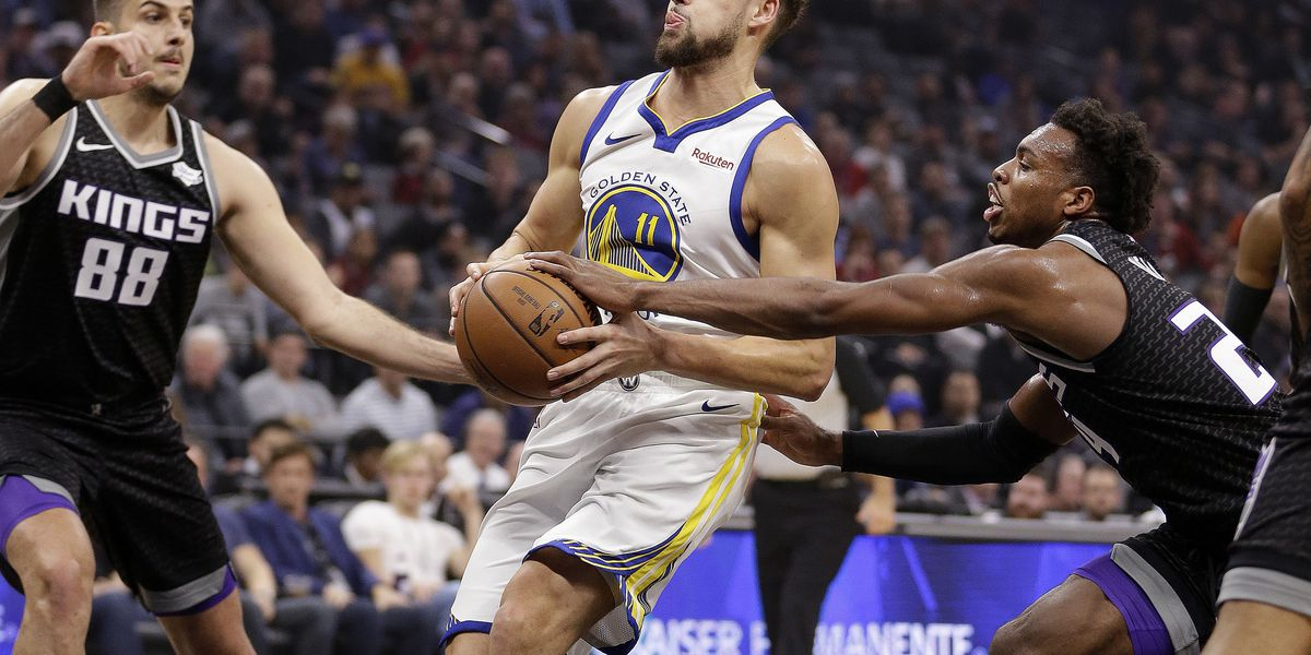 Curry, Thompson help Warriors beat Kings 130-125