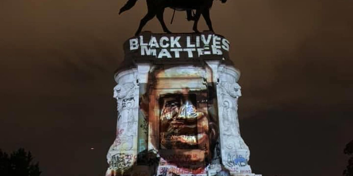 Man projects George Floyd's face over Lee monument at night