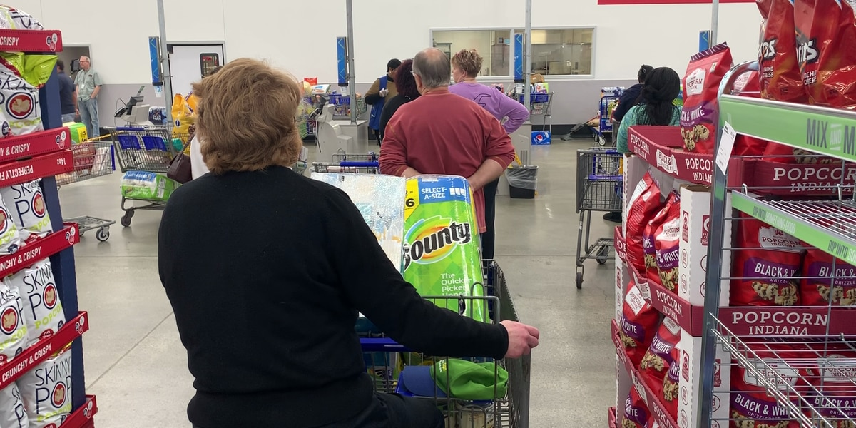 Long lines, empty shelves as people flock to stores amid coronavirus threat