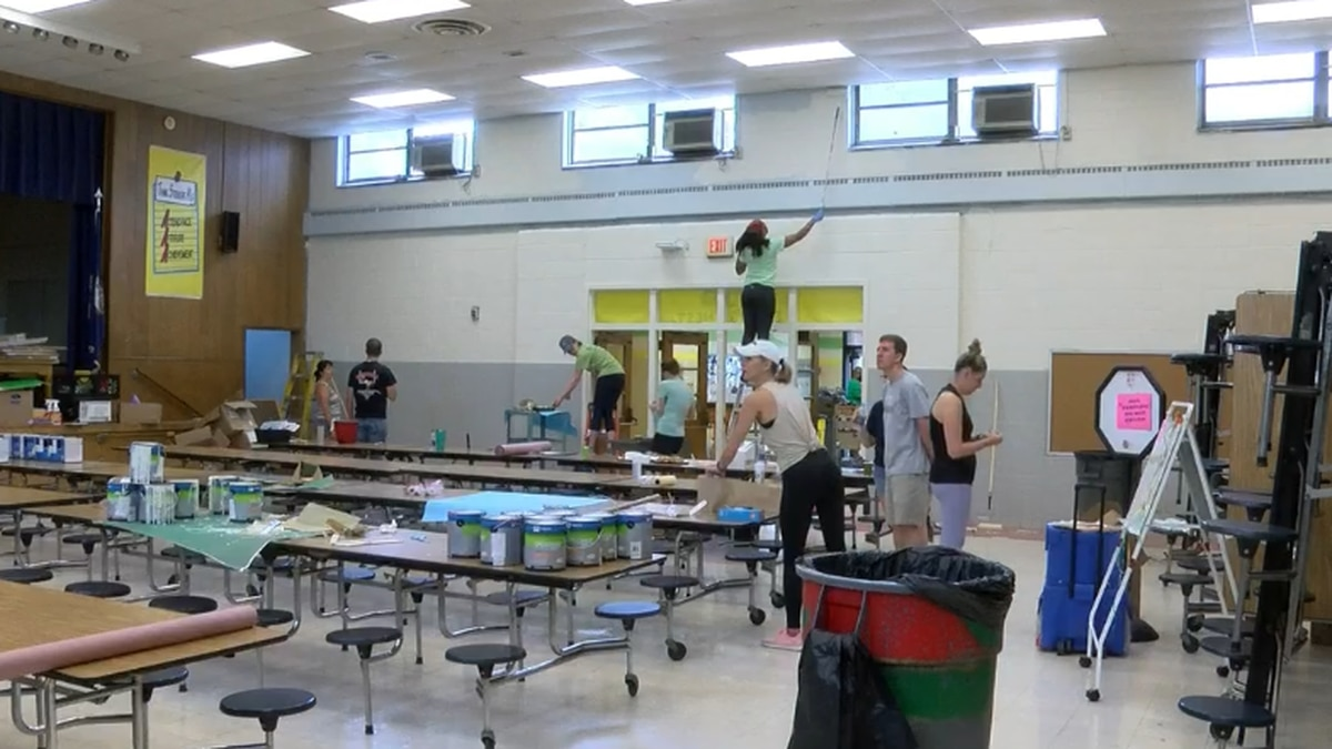 Staff, volunteers gather to clean, beautify RPS school