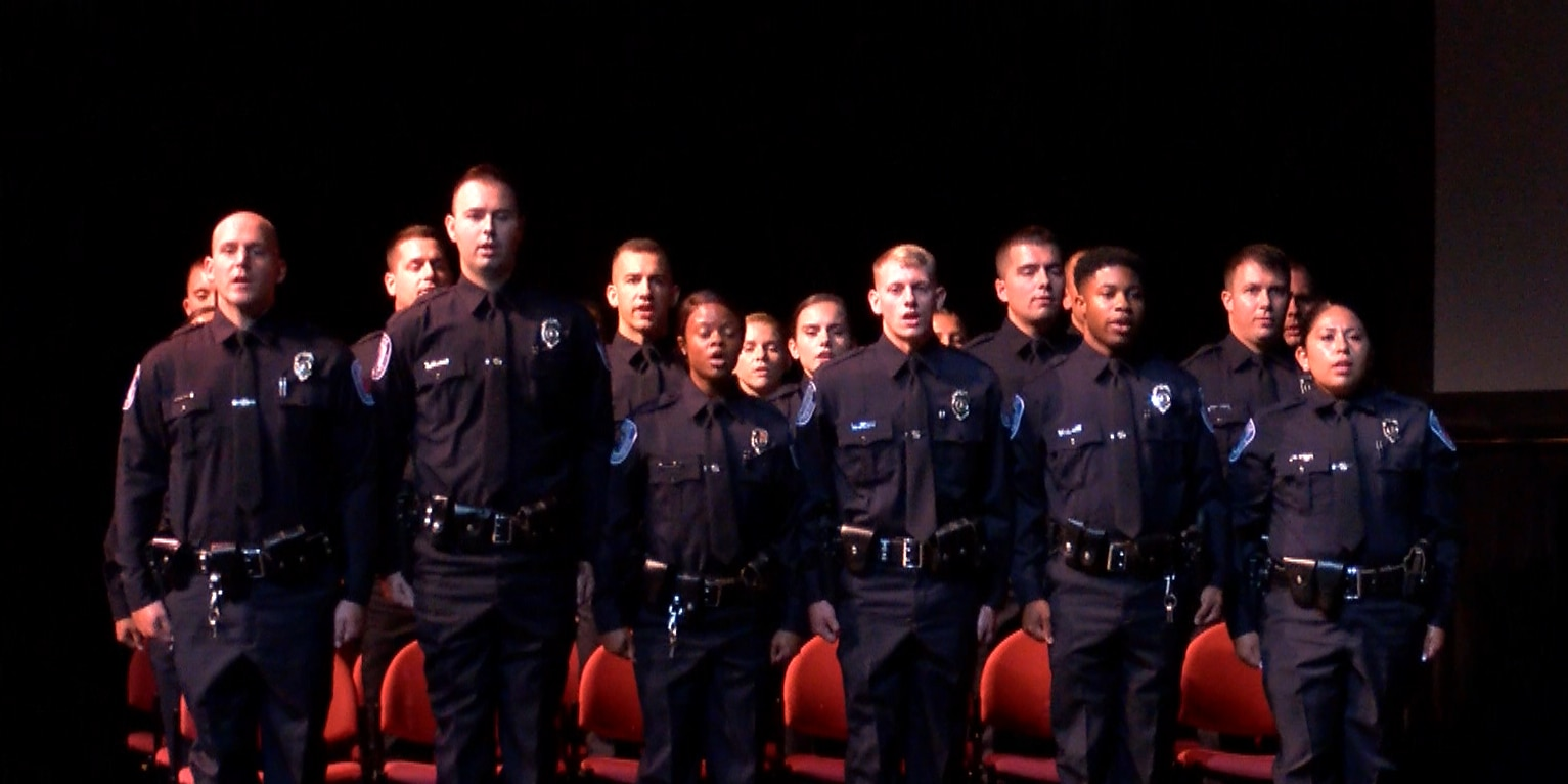 From family pinnings to a proposal, 19 RPD officers graduate academy